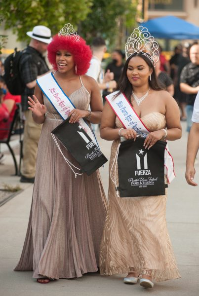 Two girls walk in gowns