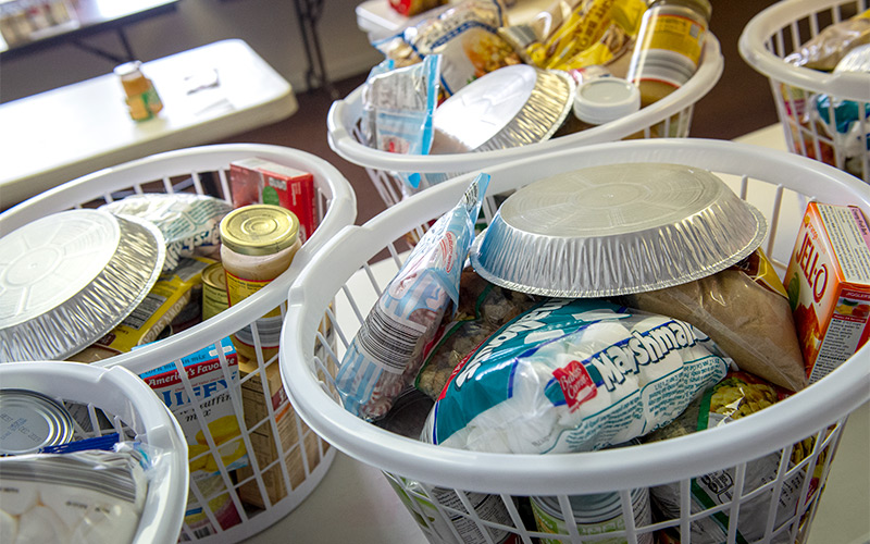Food items are prepared to be distributed through the food pantry at St. Jude the Apostle church in Gates Dec. 21, 2016.