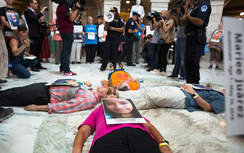 Catholic leaders and advocates lay on the floor of the Russell Senate Office Building in Washington July 18, 2019, to protest the Trump administration's handling of detained immigrant children. (CNS photo/Tyler Orsburn) See CATHOLIC-ACTION-IMMIGRANT-CHILDREN July 18, 2019.