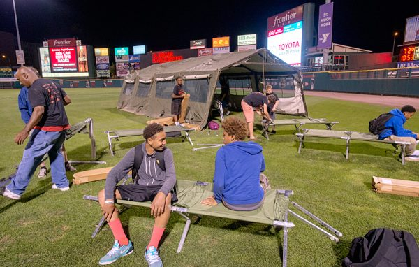 Youth set up camp on baseball field.