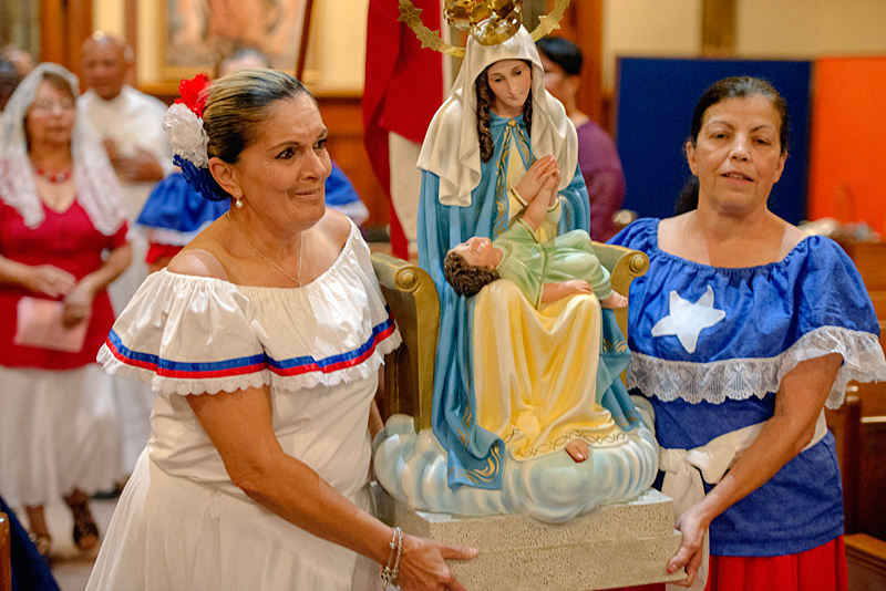 Women carry statue of Mary.