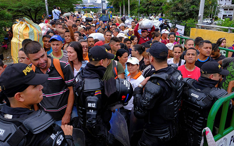 Colombian riot police in Cucuta block the way to the Colombian side in the Colombian-Venezuelan border April 2, 2019. The Biden administration announced March 8, 2021, it is offering 18-months of Temporary Protected Status to about 320,000 Venezuelans in the U.S. who fled their country's economic collapse. (CNS photo by Ferley Ospina/Reuters)