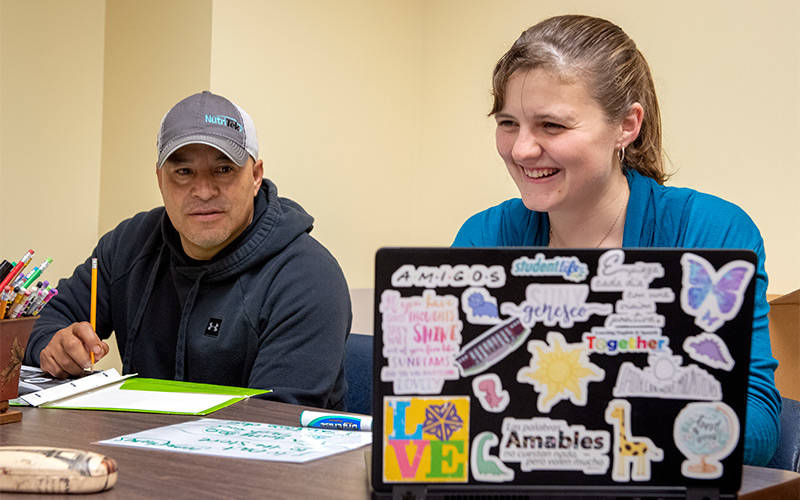 SUNY Geneseo student Karen Caswell tutors Juan Drejo in English through the Project Together program Sept. 15, 2019. (EMC file photo)