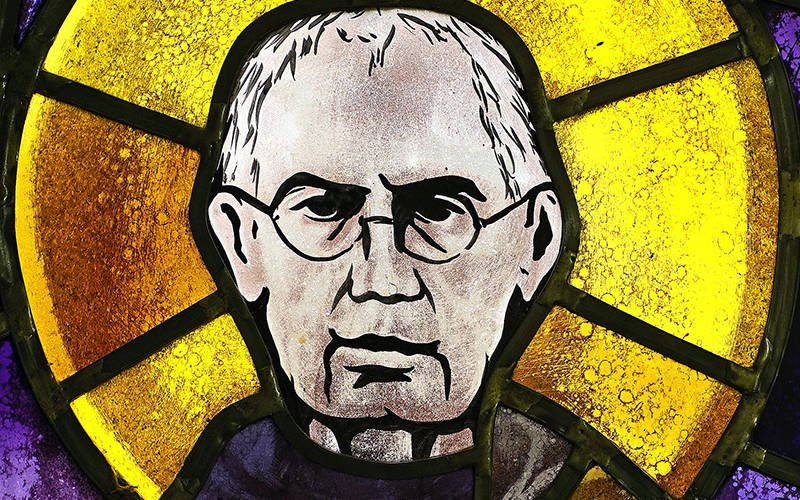St. Maximilian Kolbe is depicted in a stained-glass window at St. Josaphat Church in the Queens borough of New York City. The Polish priest gave his life in place of a young father condemned to execution by the Nazis. His feast day is Aug. 14, the day of his death. Bishop Matano mentions St. Maximilian Kolbe in his column. (CNS photo by Gregory A. Shemitz)