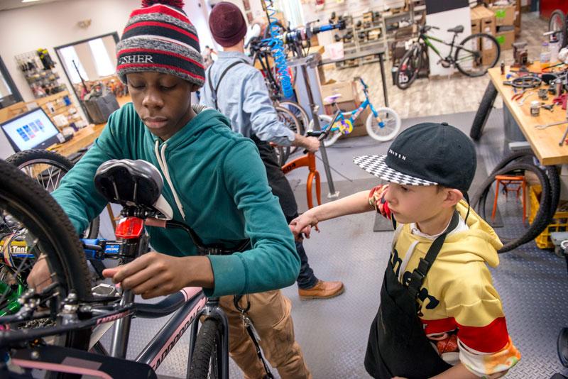 Shandon Jones,18, (left) and Clark Zimmermann, 14, (right) repair donated bikes at Dream Bikes on University Avenue in Rochester Jan. 27.