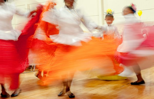 Dancers are blurred from movement.