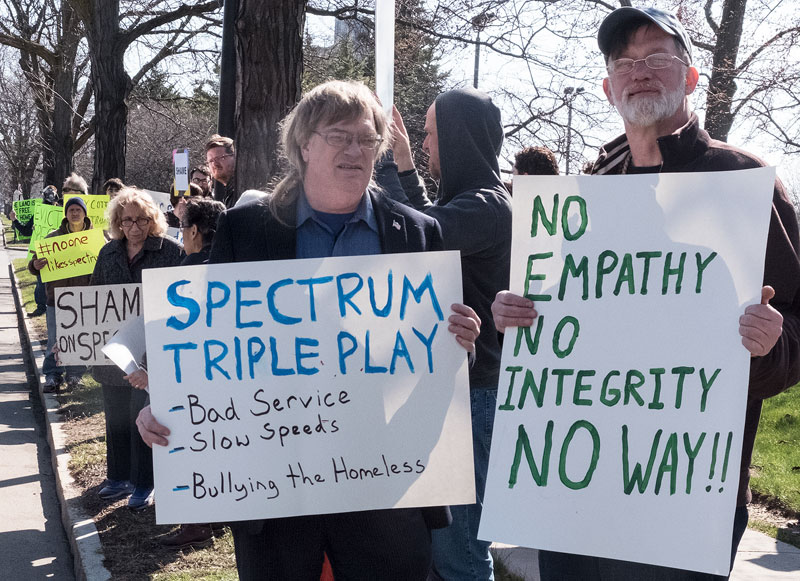 About 75 people picketed in front of Spectrum to prostest the evict of a homeless encampment near the Spectrum offices on April 26 in Rochester. (EMC Photo by John Haeger)
