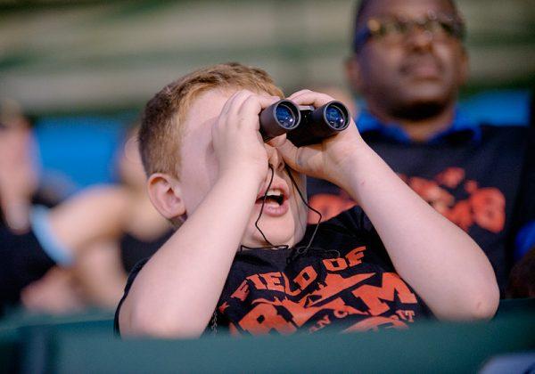 Boy looks through binoculars.