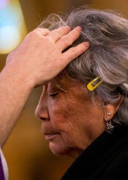 A woman receives ash.