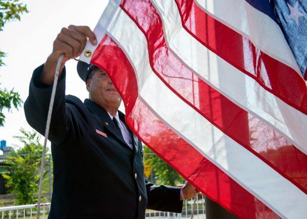 Fireman holds American flag.