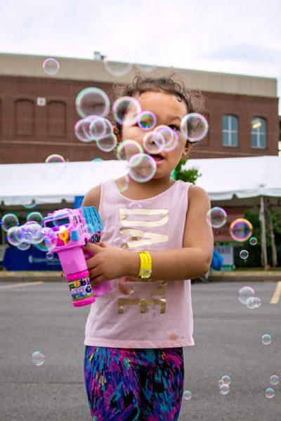 Girls blows bubbles