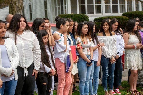 Girls gather outside.