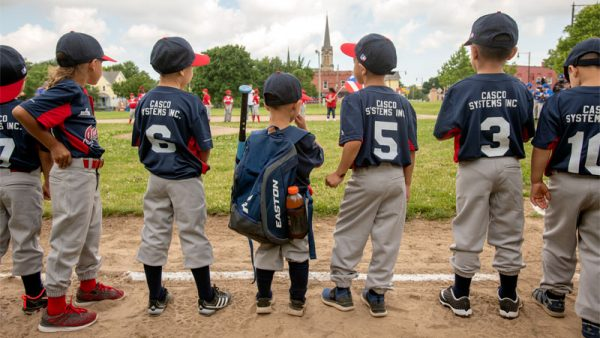 Kids line up for baseball