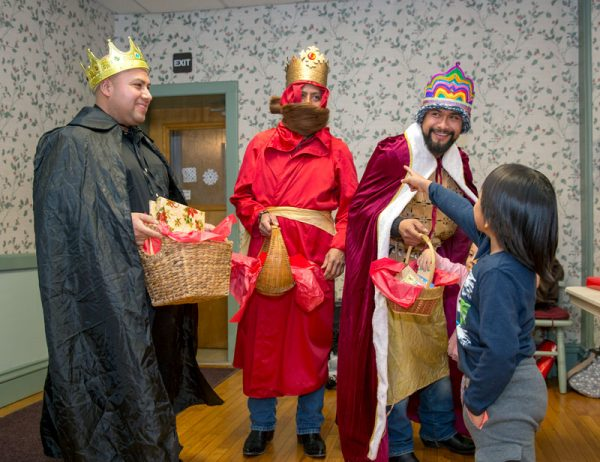 Macario Emilimo (from left,) Victor Cortez and Luis Jiménez dressed as the Magi to hand out gifts to children during a Three Kings celebration hosted by Alianza Agricola Jan 5 in Avon.