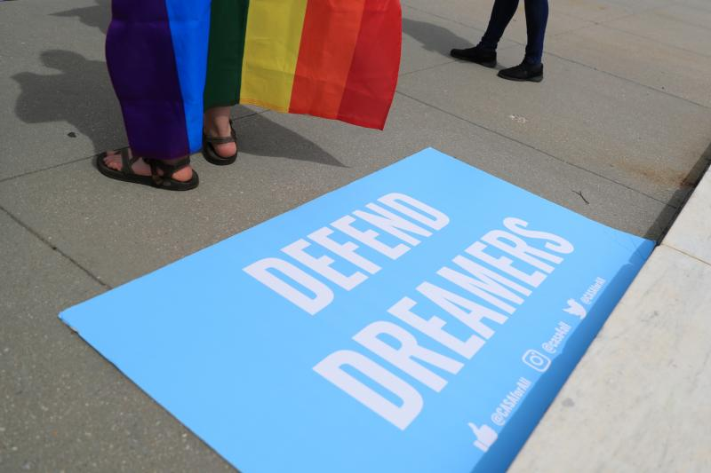 "A sign in support of DACA ""Dreamers"" lays on the steps of the U.S. Supreme Court in Washington June 15, 2020. On June 18 the Supreme Court rejected the Trump administration's executive order to cancel the Deferred Action for Childhood Arrivals program, which provides legal protections and work authorization to immigrants brought to the U.S. as children by their parents without legal documents."