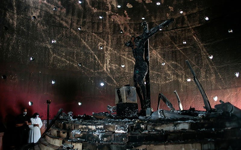 A priest and nun pray in the Blood of Christ Chapel at the Metropolitan Cathedral in Managua, Nicaragua, July 31, 2020, after the chapel was destroyed in an arson attack.
