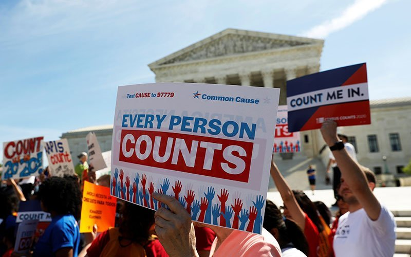 "Demonstrators gather outside the U.S. Supreme Court in Washington April 23, 2019, following oral arguments on a citizenship question for the census. A federal court ruled Sept. 10, 2020, that excluding immigrants in the country illegally from the census count would violate the 14th Amendment, which requires the number of House seats each state is allotted to be based on ""counting the whole number of persons in each state."""