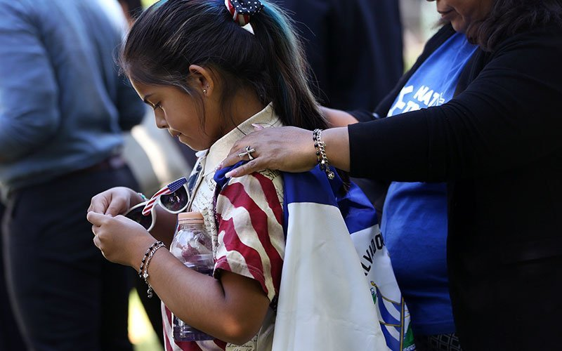 Marilyn Miranda, 9, draped in a Salvadoran flag, attends an immigration rally with her mother outside the U.S. Capitol in Washington June 4, 2019. A Sept. 14, 2020, decision from the U.S. Court of Appeals for 9th Circuit in Ramos v. Nielsen brings the Trump administration one step closer to ending Temporary Protected Status, or TPS, for almost all people with TPS in the United States.