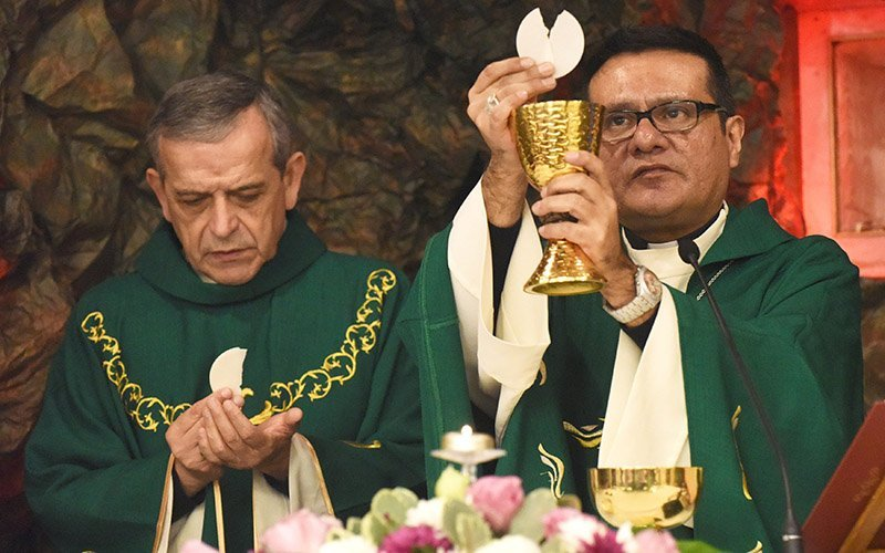 Seattle Auxiliary Bishop Eusebio L. Elizondo and Detroit Auxiliary Bishop Arturo Cepeda concelebrate Mass Jan. 21, 2018, at St. Joseph Church in Jifna, West Bank. In a Sept. 15, 2020, statement marking the beginning of Hispanic Heritage Month in the U.S., Bishop Cepeda, chairman of the U.S. Conference of Catholic Bishops' Subcommittee on Hispanic Affairs, said the Catholic Church and U.S. society must acknowledge the historic and current contributions of Hispanic and Latino leadership in all spheres of church and society.