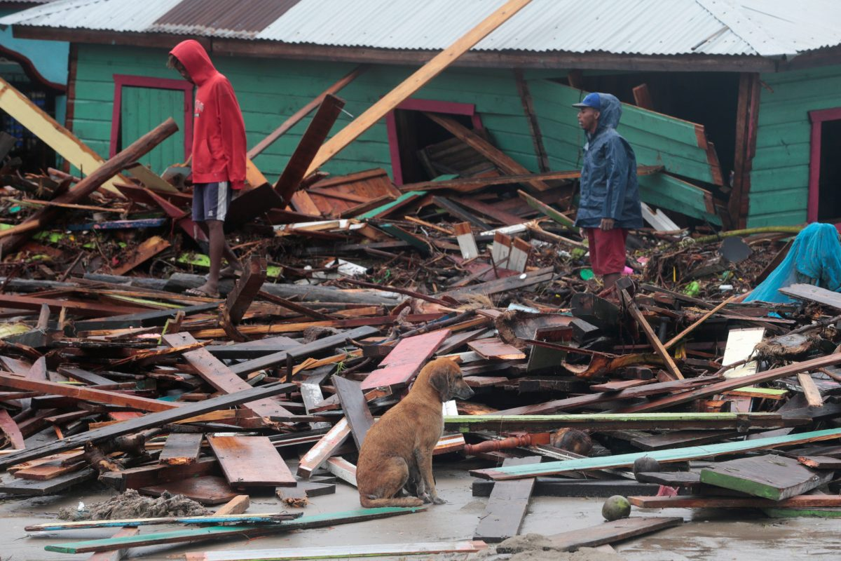 Residents stand amid debris outside homes in Puerto Cabezas, Nicaragua, Nov. 17, 2020, in the aftermath of Hurricane Iota. The Category 4 storm hit the coast of Nicaragua near the border of Honduras Nov. 16, causing storm surges and flooding and further damaging buildings already wrecked by Hurricane Eta.