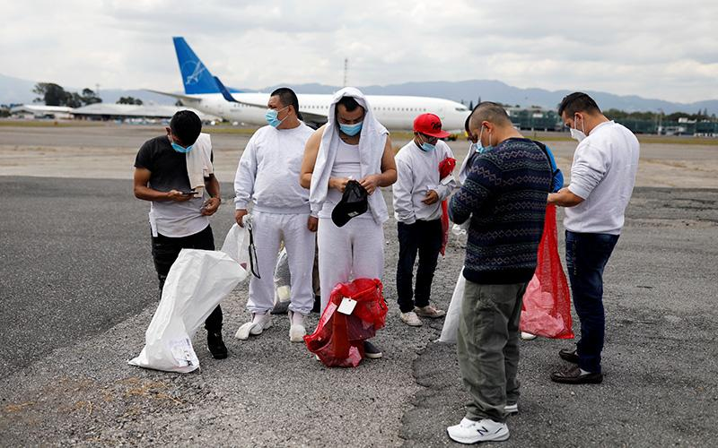 Guatemalan migrants stand on the tarmac at La Aurora International Airport in Guatemala City Jan. 6, 2021, after being deported from the United States. A federal circuit court of appeals said Jan. 8 that a Trump administration executive order that would allow state and local government officials to reject refugees in their jurisdiction violated long-standing resettlement practices. (CNS photo by Luis Echeverria/Reuters)