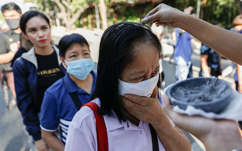 Worshippers wearing protective masks receive ashes during Ash Wednesday Mass at the National Shrine of Our Mother of Perpetual Help in Manila, Philippines, Feb. 26, 2020, during the COVID-19 pandemic. The Vatican Congregation for Divine Worship and the Sacraments has issued a note on how priests can distribute ashes on Ash Wednesday while taking precautions to avoid spreading COVID-19.