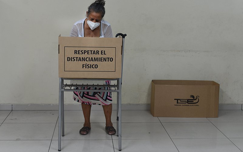 A woman votes at Romero Albergue School in San Salvador Feb. 28, 2021, during the municipal and legislative elections in El Salvador. (CNS photo by Lissette Lemus)
