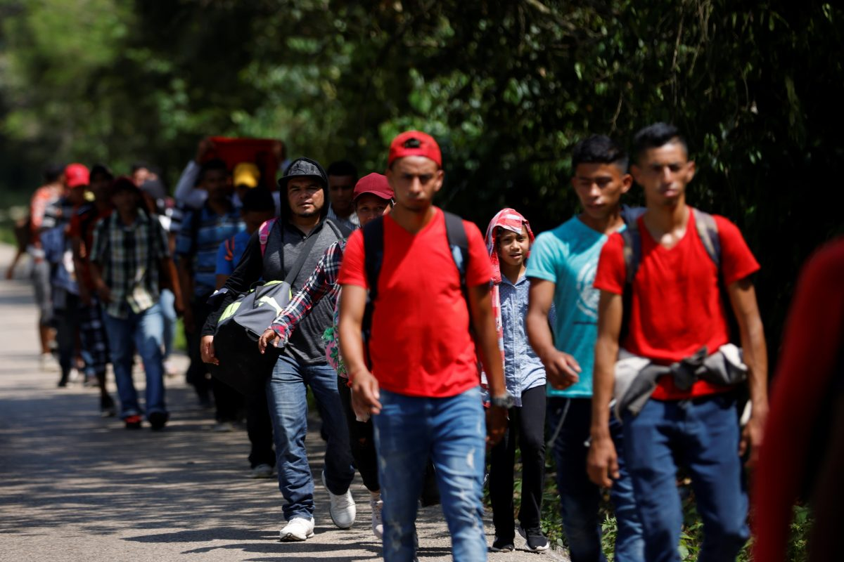 A group of young Central American migrants walk along a highway in Palenque, Mexico, March 28, 2021, on their way to seek asylum in the United States.