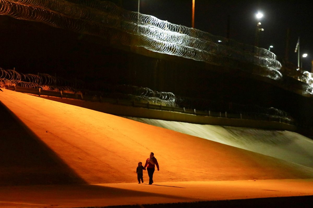Migrants from Honduras walk toward Border Patrol agents in El Paso, Texas, to turn themselves in March 29, 2021.