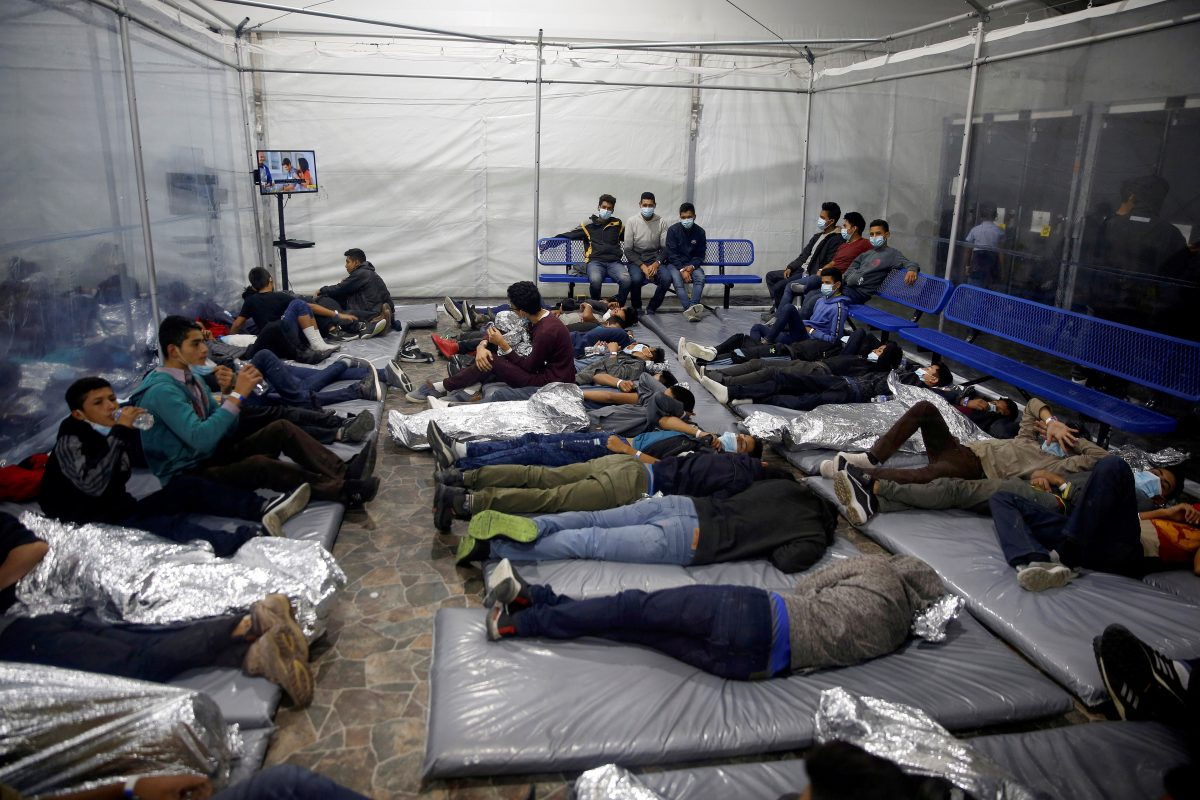 Young migrants lie inside a pod March 30, 2021 at the holding facility in Donna, Texas, set up in February by U.S. Customs and Border Protection, an agency within the Department of Homeland Security.
