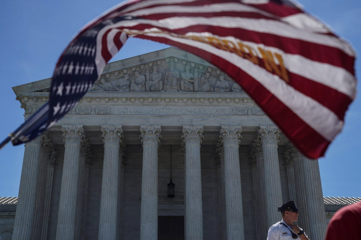 A U.S. flag flies in front of the Supreme Court in Washington June 25, 2018.