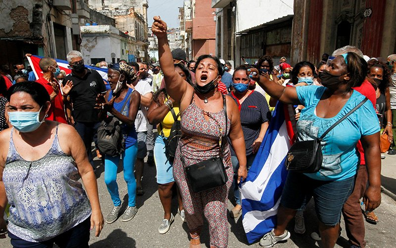 Government supporters react during protests in Havana July 11, 2021. Thousands of Cubans took to the streets in rare anti-government demonstrations to protest a lack of food and medicine as the country undergoes an economic crisis aggravated by the COVID-19 pandemic and U.S. sanctions. (CNS Photo by Reuters)