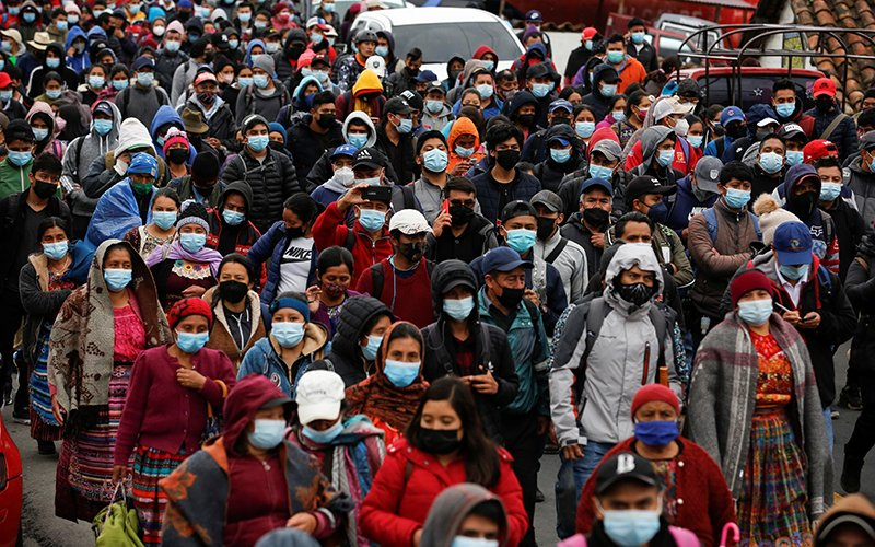 Guatemalans march during a protest demanding the resignation of President Alejandro Giammattei and Attorney General María Consuelo Porra in San Cristobal Totonicapan July 29, 2021.