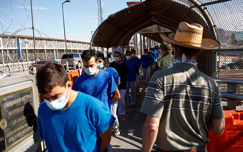 Migrants expelled from the U.S. and sent back to Mexico under Title 42 walk toward Mexico at the Paso del Norte International border bridge, in this picture taken from Ciudad Juarez, Mexico, July 29, 2021. (CNS photo by Jose Luis Gonzalez/Reuters)