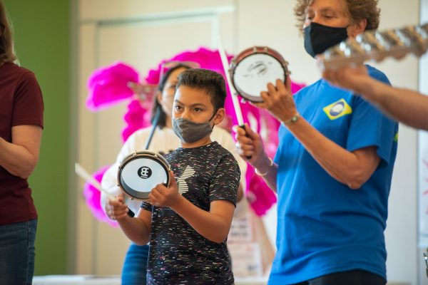 Maximo Carreras plays the tambourine during a drumming demonstration June 6 at Webster Recreation Center during the Carnival EXPO celebrating Latin American culture and traditions.