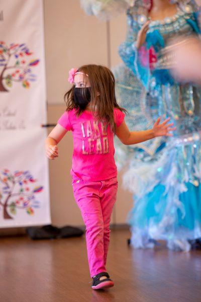 Catalina Arielle Perea dances during a children's dance lesson.