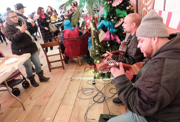 Musicians perform during the Three Kings Day celebration at Roc Holiday Village Dec. 28.