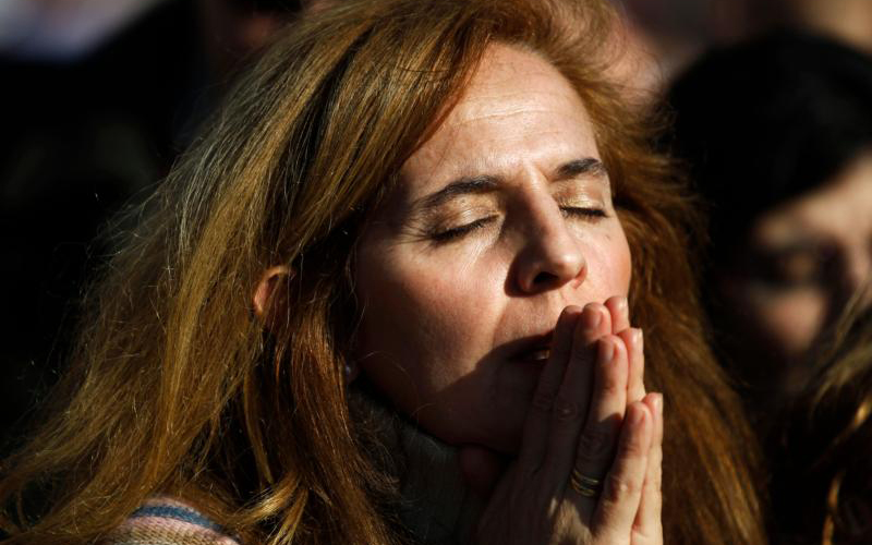 "A woman prays during Mass in favor of the traditional family unit in central Madrid in this 2011 file photo. Spanish church leaders voiced concern for their country's future after the government pledged to legalize euthanasia, secularize education and strip the church of ""improper assets."" (CNS photo/Susana Vera, Reuters) See SPAIN-CATHOLICS-SECULARIZE Jan. 9, 2020."