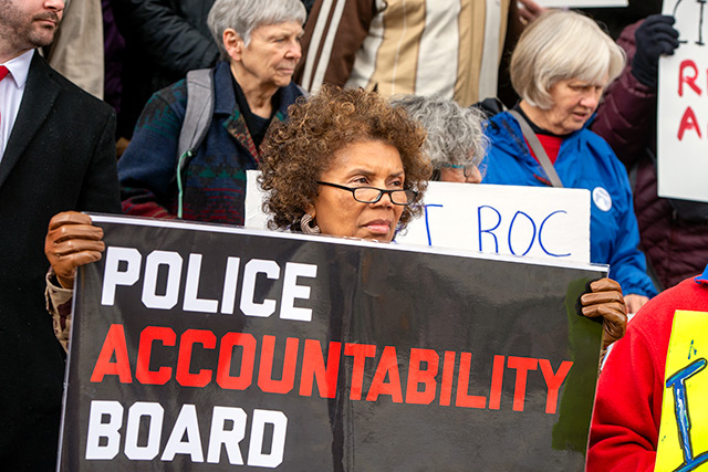 Gayle Harrison participates in a 24-hour vigil supporting an all-civilian police accountability board outside of Rochester's City Hall May 2.