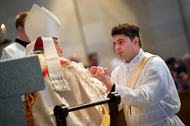Father Juan Benitez pledges his obedience to Bishop Salvatore R. Matano during the June 3 priest ordination Mass at Rochester's Sacred Heart Cathedral.