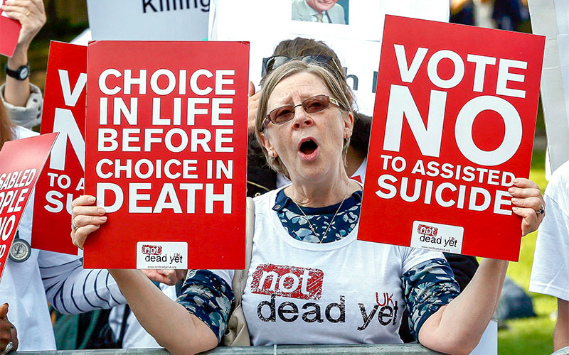 A demonstrator against assisted suicide joins a protest outside Parliament in London Sept. 11, 2015. On March 21, the professional body for doctors in the U.K. dropped its traditional opposition to assisted suicide, in spite of a poll that found that a majority of its members remain opposed to the practice. (CNS photo/Stefan Wermuth, Reuters) See BRITAIN-ASSISTED-SUICIDE-PHYSICIANS March 21, 2019.