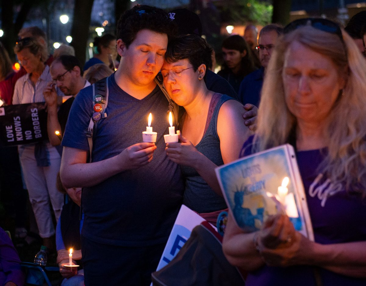 "A moment of silence is observed during ""Lights for Liberty: A Vigil to End Human Concentration Camps"" at Washington Square Park in Rochester July 12."
