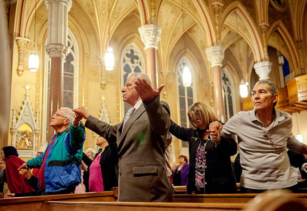 People join hands in Mass.