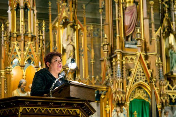 A woman speaks in church.