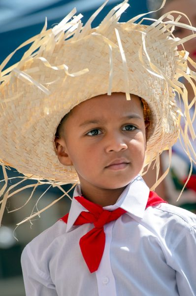 A boy dresses in traditional Puerto Rican attire.