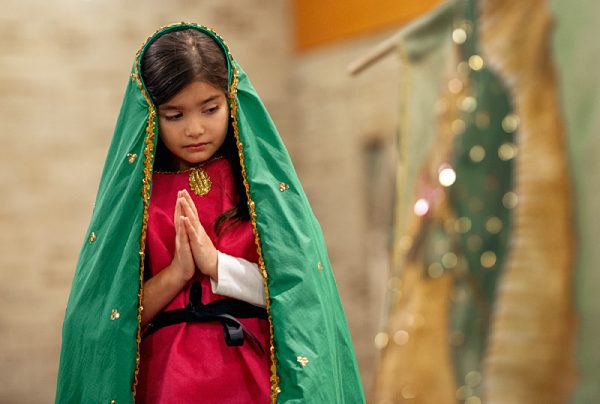 Girl dressed as the Virgin Mary.