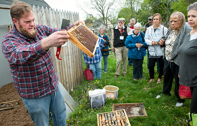 Austin Pettigrew of Sweet Beez explains about urban bee keeping during the second annual Rochester Urban Agriculture Conference on May 13 in Rochester. El Mensajero by John Haeger