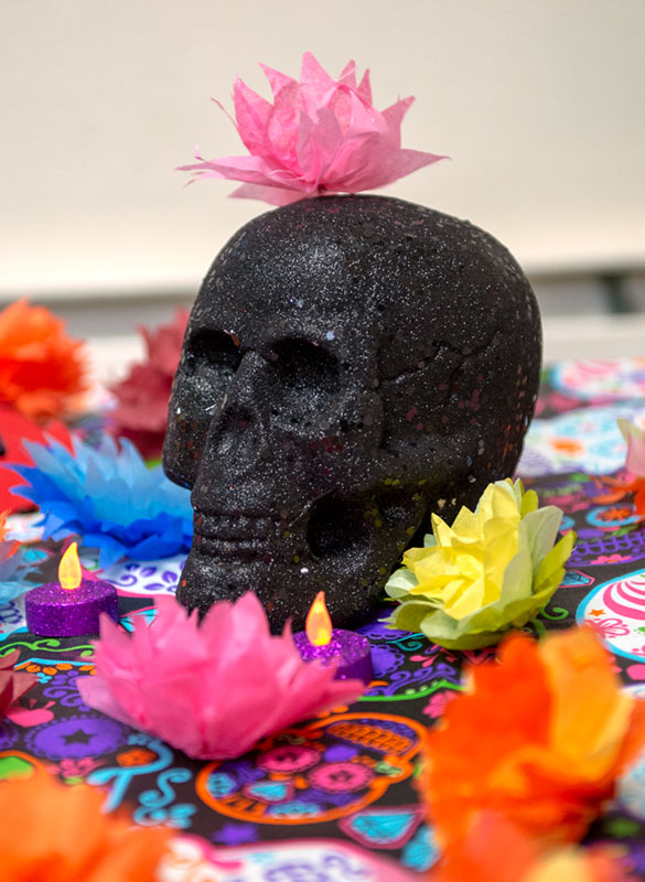 A black skull decorated in flowers.