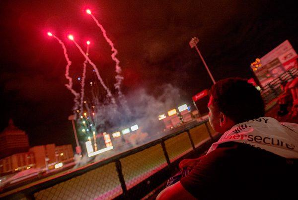 Kids watch fireworks.