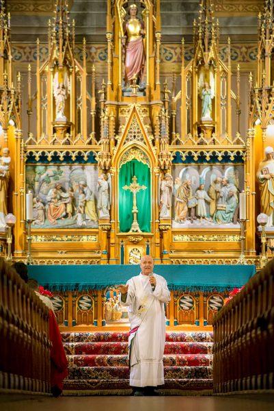 A deacon speaks in church.